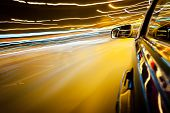 Night traffic,shoot from the window of rush car,motion blur street light. poster