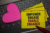 Writing note showing Empower Engage Enable Enhance. Business photo showcasing Empowerment Leadership Motivation Engagement Red bordered yellow written paper pinch with love on computer keybaord poster