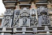 Ornate wall panel reliefs depicting, from left, Sundari, Arjuna shooting arrow, Lord Vishnu, Kamadeva and his consort Rati and Lord Vishnu, Chennakesava temple, Belur, Karnataka, india. poster