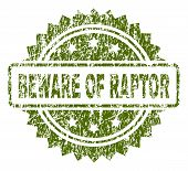 BEWARE OF RAPTOR stamp seal watermark with rubber print style. Green vector rubber print of BEWARE OF RAPTOR title with retro texture. poster