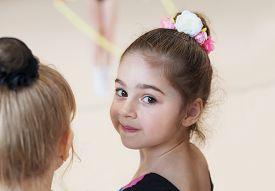 Little Cute Ballerina In Studio Looking On Camera. Sport, Training, Fitness, Stretching, Dancing, Yo