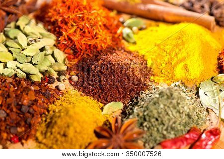 Spices. Various Indian Spices colorful background. Indian Spice and herbs backdrop. Assortment of Seasonings, condiments. Cooking ingredients, flavor