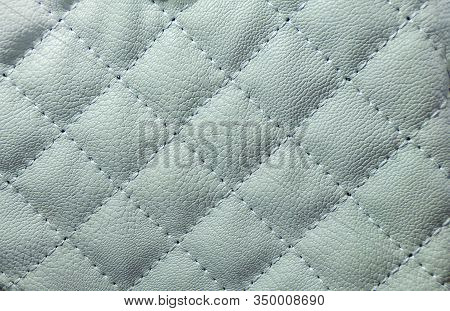 The Upholstery Of The Sofa As An Abstract Background And Texture Of The Upholstery. Diamond-shaped L