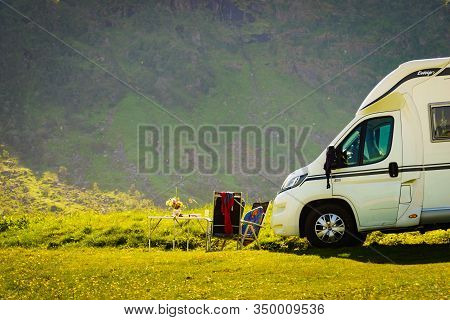 Gimsoya, Norway - July 17, 2018: Camper Car Laika Ecovip Motor Home With Tourist Chairs And Table On