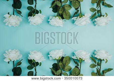Spring Freshness Card With Flowers Pattern. White Roses With Green Leaves On Blue Background. Beauti