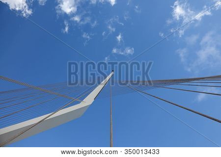 The new ultra-modern white bridge in Jerusalem. Strings suspension bridge and snow-reliance against the blue sky