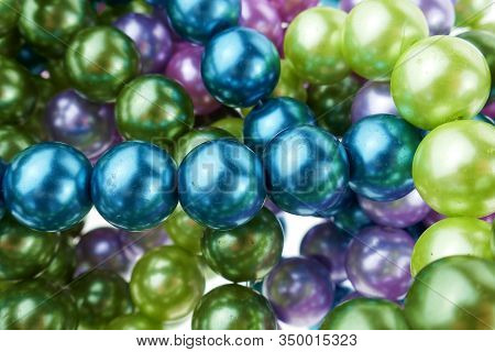 Colored Pearls Close-up. Pearl Beads Round Background.blue, Purple, Green And Pink Beads Texture.bea