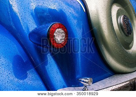 Tail Light And Spare Tire Of A Retro Car. Detail Of The Interior Of A Vintage Car. Chrome Bumper And