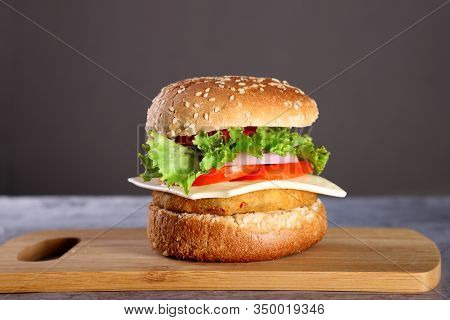 Fast Food - Burger On A Wooden Board