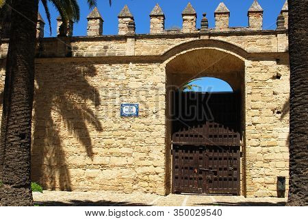 Jerez De La Frontera, Spain - August 20, 2008 - Wall With Battlements And Large Gate In The Castle C