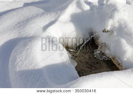 Frozen Snow Frozen Faucet Winter. A Frozen Faucet During Wintertime. Outdoor Faucet Frosted.