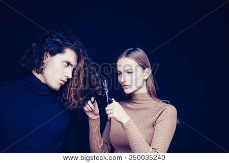 Family Crisis. Girl Scheming An Evil Plan Of Cutting Off A Curly Hair In A Man. A Smart Wily Woman H