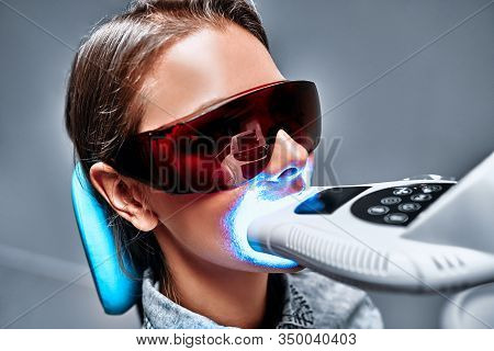Close-up View Portrait Of A Female Patient At Dentist In The Cli
