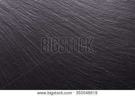 Black Stone, Texture For The Background. Smooth Shadows And Light On The Structural Surface
