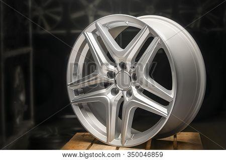 Alloy Wheel Silver, Rim New Car Wheel On A Black Background