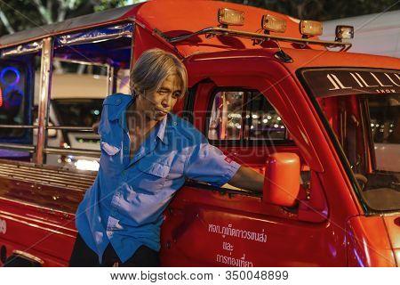 Thailand, Phuket, Patong, February 1, 2020: Blurr, Soft Focus, Tuk Tuk Driver, Stylish Thai Man, On