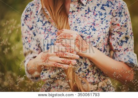 Hands Of A Girl With Drawings Of Mehendi In The Style Of Boho.