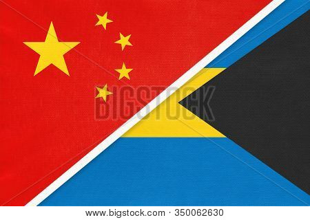 China Or Prc Vs Bahamas National Flag From Textile. Relationship Between Asian And American Countrie