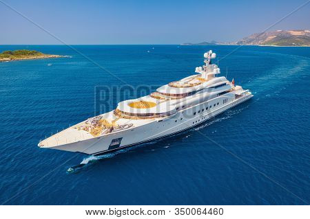 Aerial View Of Luxury Yacht And Blue Sea At Sunny Bright Day In Summer. Big White Modern Boat. Top V