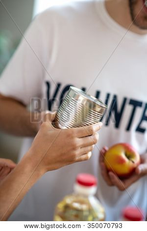Can Of Iron, Which Is Handed Over To The Volunteer.