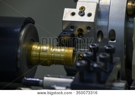 The Cnc Lathe Machine Thread Cutting At The Brass Shaft Pipe Connector Parts. The Brass Water Pipe C
