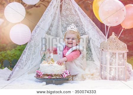 happy smiling baby with cake smash birthday party and cheeky smile