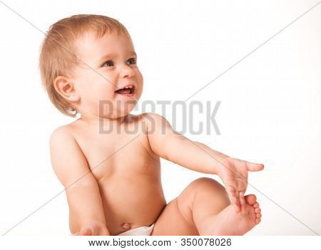Close Up Of Cute Happy Child Placing Hands On Ears. Joyful Infant Kid Looking Aside And Smiling. Iso