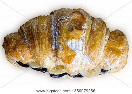 Croissant With Chocolate Butter And Banana Isolated On A White Background.