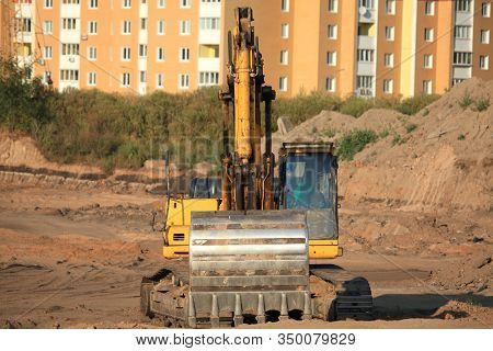 Excavator (digger) With A Huge Bucket At A Construction Site. Construction Machinery At The Facility