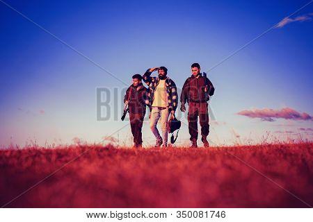 Autumn Hunting Season. Rifle Hunter Silhouetted In Beautiful Sunset. Hunting In Usa. American Huntin