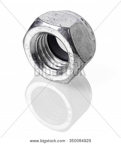 Old And Dirty Steel Nut Isolated On White Background And Reflective