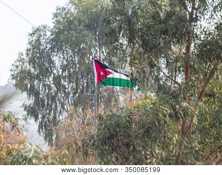 Jericho, Israel, January 18, 2020 : Jordanian Flag Flies In The Wind On The Jordanian Part Of The Ba