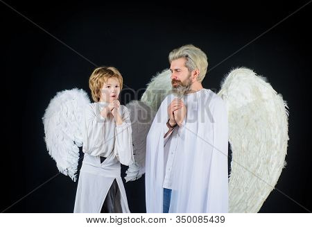 Happy Father In Angel Costume With Little Son Angel. Christmas Angels. Cute Angel. Gorgeous Kid. Val