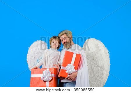 Cute Angel. Little Angel Boy Gives Father Gift. Happy Father In Angel Costume With Little Son Angel