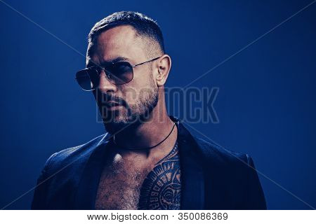 Mans Fashions, Stylish Male Model. Closeup Man Portrait. Man Face. Handsome Bearded Man - Face Half