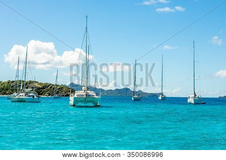 Turquoise Colored Sea With Ancored Yachts And Catamarans, Tobago Cays Tropical Islands, Saint Vincen