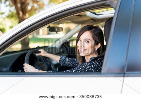 Smiling Mid Adult Attractive Woman Driving New Car