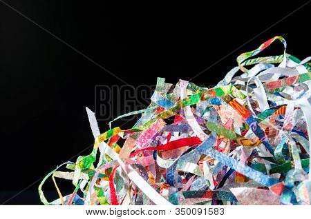 Closeup Shredded Paper Texture And Reuse Colorful Paper Scrap Of Document On Black Background. Selec