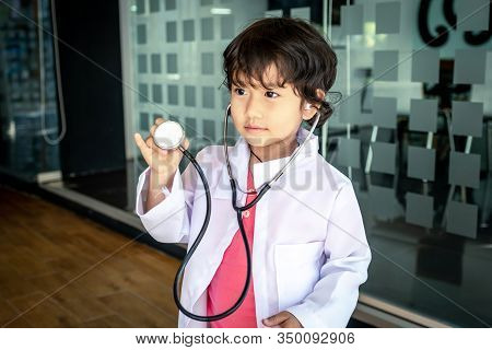 Photo Of Kid Doctor With Stethoscope Working In The Office.