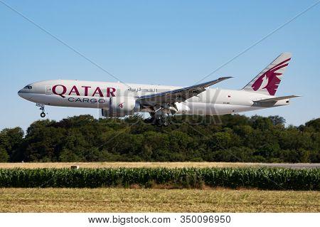 Findel - Luxembourg / July 8, 2018: Qatar Airways Cargo Boeing 777-200 A7-bfl Cargo Plane Arrival An