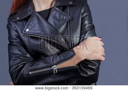 Close-up Portrait Of A Girl In A High-quality Leather Jacket. Rock And Roll Style In Women. Promotio