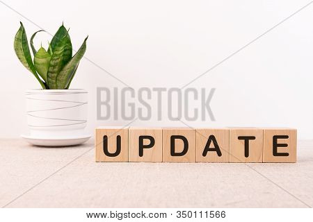 Update Message Sign On A Light Table With A Flower On A Light Background