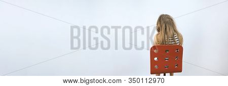 Girl Sitting On Red Chair. Mental Health Concept. Teenager In Depression. Kid At Reception Of Psycho