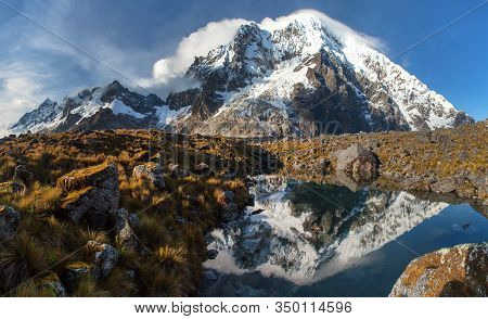 Evening View Of Mount Salkantay Mirroring In Lake, Salkantay Trek In The Way To Machu Picchu, Cuzco