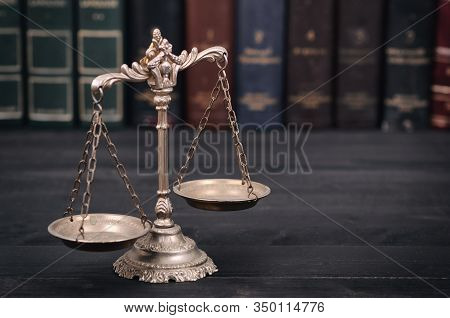 Law And Justice, Legality Concept, Scales Of Justice On A Black Wooden Background.