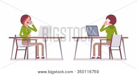 Young Woman Wearing Hoodie Sitting, Working With Laptop At The Desk. Cute Lady In A Casual Hoody At