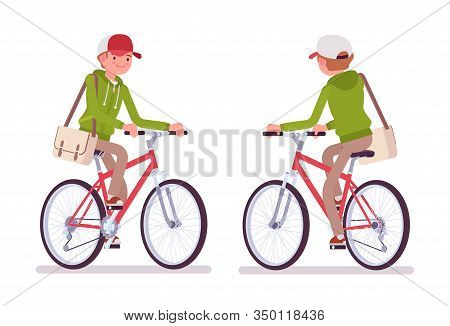 Young Man Wearing A Hoodie Riding A Bike. Cute Guy In A Casual Hoody Cycling, Traveling By Bicycle,