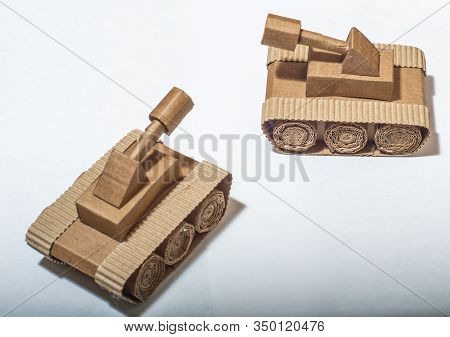 Two Toy Tanks Made By Children From Corrugated Cardboard Are Fighting. Toy Cardboard Tanks Isolated