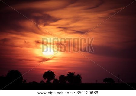 Silhouette Rural Landscape With Trees And Fields During Sunset