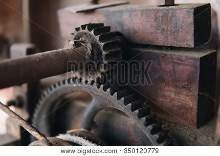Detail Of Old Vintage Machine Made From Wood And Metal Cogwheel